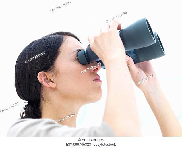 Young lady looking through binoculars