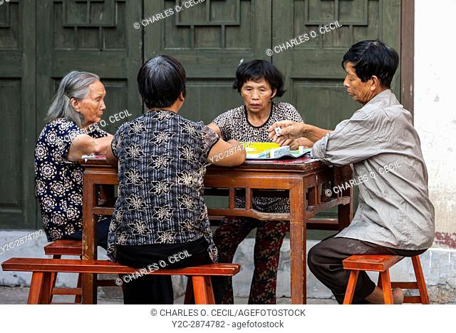Cangpo, Zhejiang, China. Local Residents Playing Mahjong