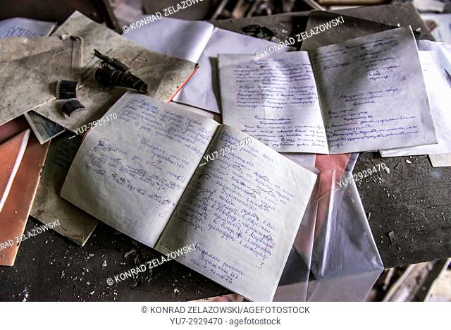 Children's notebooks in High school No 3 in Pripyat ghost city of Chernobyl Nuclear Power Plant Zone of Alienation around nuclear reactor disaster in Ukraine