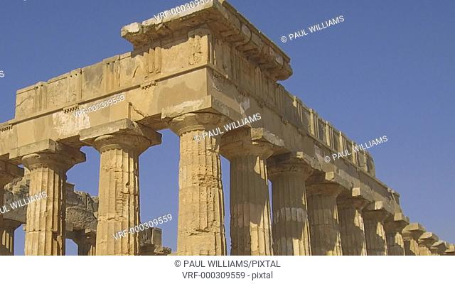 Zoom back from close of the Greek Doric Temple columns of the ruins of the Temple of Hera, Temple E, Selinunte, Sicily