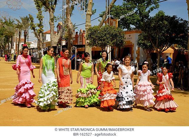 Girls in traje de gitana , Feria de Caballo , Jerez de la Frontera , Cadiz , Andalusia , Spain , Europe