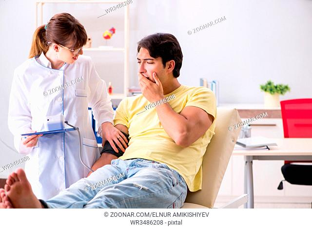 Young doctor checking patients blood pressure