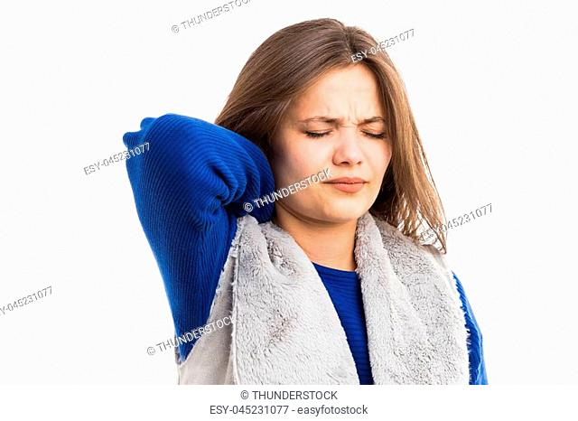Young woman suffering strong neck pain ache as stress tension or physical problem isolated on white background