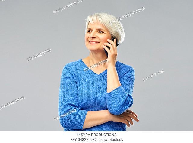 smiling senior woman calling on smartphone