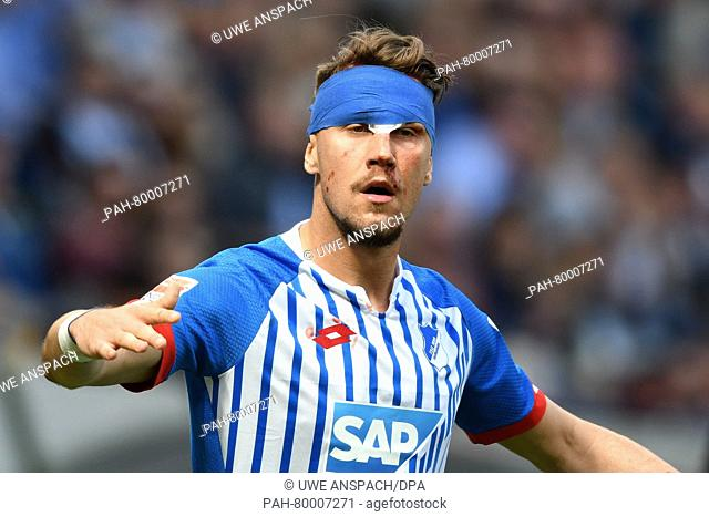Hoffenheim's Ermin Bicakcic playing with a dressing after injuring his head during the German Bundesliga soccer match between TSG 1899 Hoffenheim and...