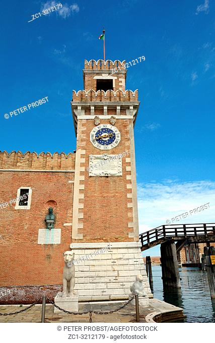 Clock tower at the entrance of the historic Venetian Arsenal and Naval Museum in Castello district of Venice - Italy