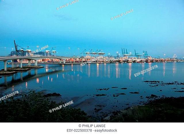 Container harbor of Algeciras illuminated at dusk. Andalusia Spain