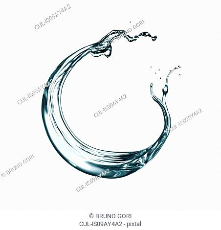 Transparent liquid swirling against white background