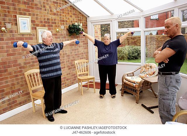 Group of geriactrics doing an exercise class