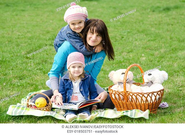 Incomplete family - mother, five-year and three year old daughter at a picnic