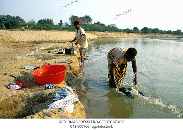 Washing clothes in the Luangwa river just opposite to the South Luangwa National Park. Zambia