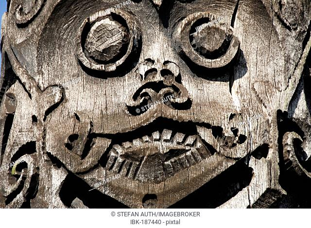 Wooden carved face at the museum in Kuching Sarawak Borneo Malaysia