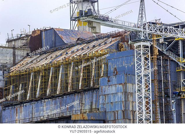 Close up on old steel and concrete sarcophagus of reactor No 4 of Chernobyl Nuclear Power Plant in Zone of Alienation in Ukraine
