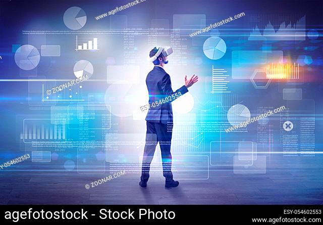 Good looking businessman checking reports and charts with vr glasses