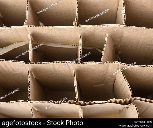 brown corrugated paper cardboard box with partitions, glass bottle transport box, close up
