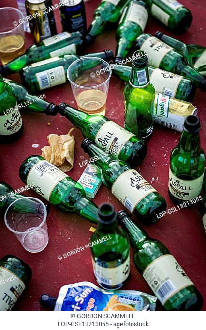 England, Essex, Stow Maries. Empty bottles discarded at the Brownstock Festival in Essex