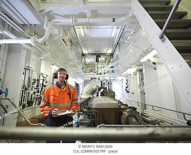 Engineers in ship's engine room