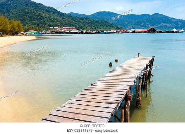Wooden jetty on exotic beach Koh Chang island, Thailand