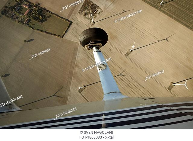 Aerial view from airplane of wind turbines in rural field, Brandenburg, Germany