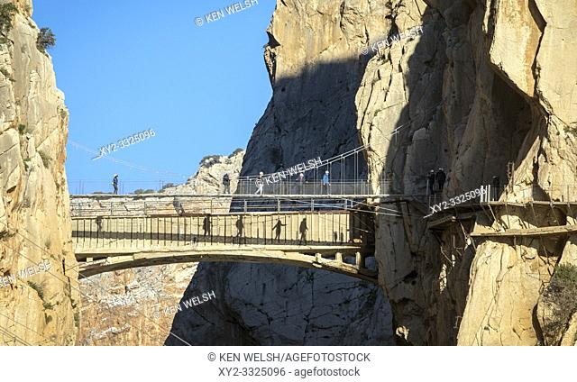 Visitors on the El Caminito del Rey or The King's Walkway. The walkway is built into the side of the gorge of El Chorro in the Desfiladero De Los Gaitanes...