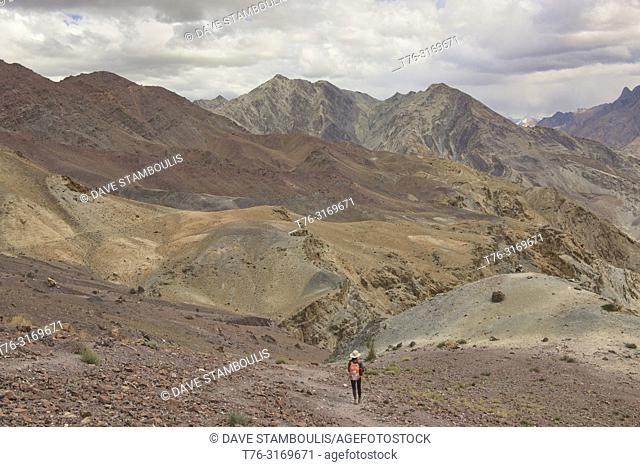 Descending to the Zanskar River with approaching storm, Ladakh, India