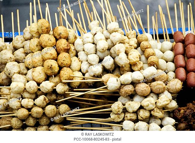 Thailand, Bangkok, unusual delicacies found at street vendor food stalls, skewers of a variety of different meatballs