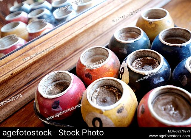 hollowed out billiard balls as a tea light holder in front of a mirror, Greece