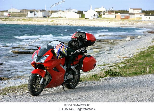 Motorcycle with Village and and Bonavista Bay in background, Sandy Cove, Newfoundland