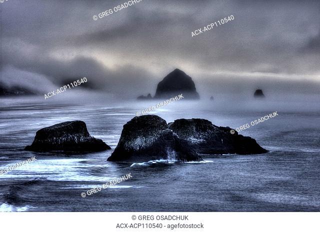 Fog over Canon Beach, Oregon at sunset, Oregon Coast