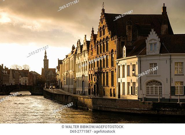 Belgium, Bruges, canalside buildings, sunset
