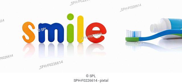 The word 'smile' in multicoloured letters with toothbrush