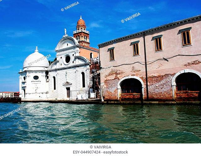 View from the Venice lagoon of the church of San Michele in Isola on the cemetery island of San Michele at sunset, Venice, Italy