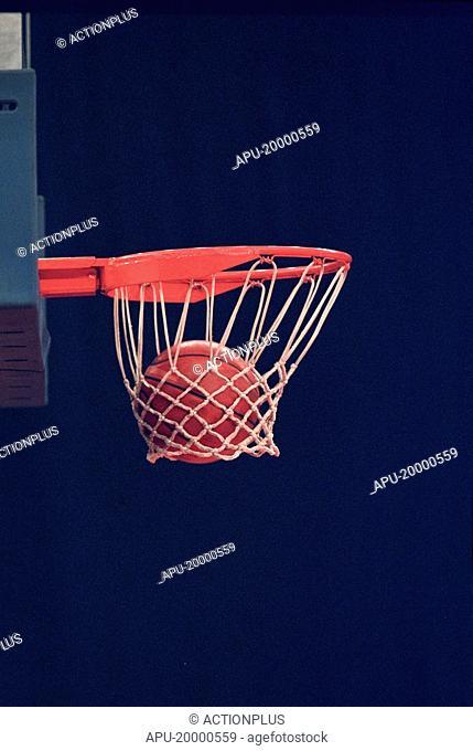 Basketball going through a hoop