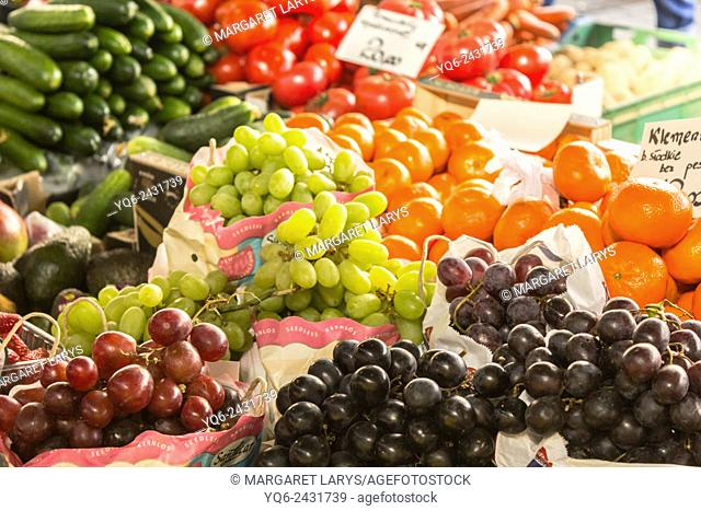 Selection of fresh, green and black grape and various vegetables at the farmers market in Krakow, Poland