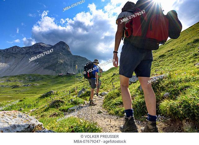 Lechtaler Alpen, Lechtal Alps, hiker legs feet at the way to mountain hut Memminger Hütte, mountain Seekopf, TirolWest Region, Tyrol, Austria