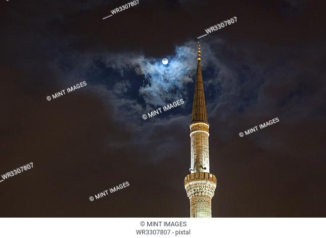 Full moon over tower of Blue Mosque at night, Istanbul, Turkey