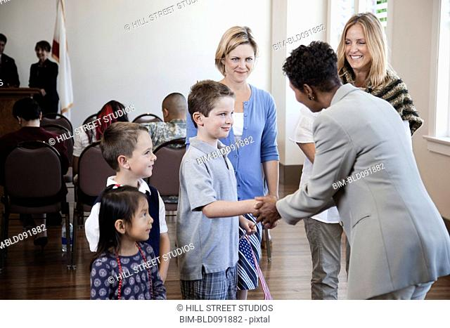 Politician greeting children at political gathering