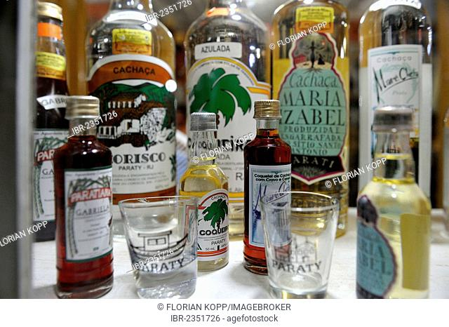 Cachaca, liquor made from fermented sugarcane juice, national drink of Brazil, on sale in a shop in Paraty or Parati, Costa Verde, State of Rio de Janeiro