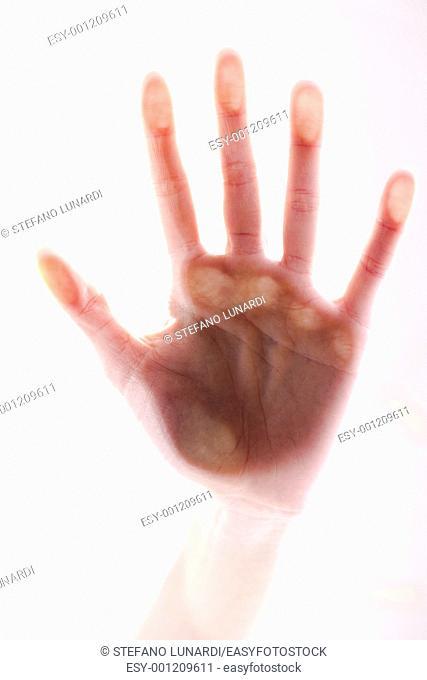 Female hand touching glass