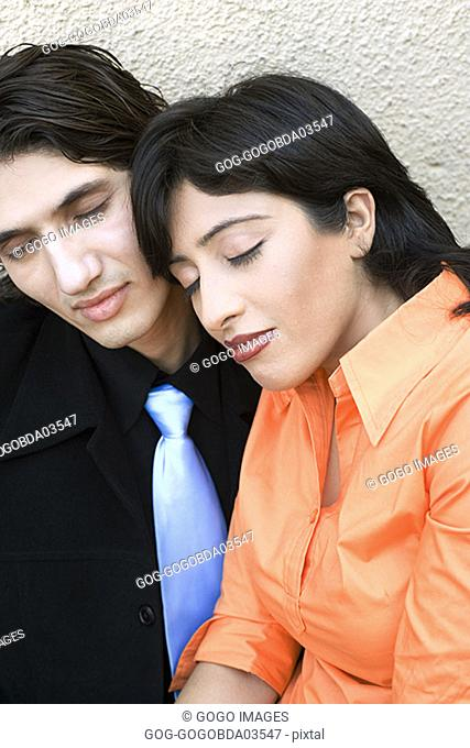 Woman sleeping on boyfriend's lap