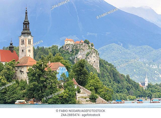 Bled, Slovenia - June 3, 2017: Tourists visiting the Cerkev Marijinega vnebovzetja Church in the Island in the center of Lake Bled