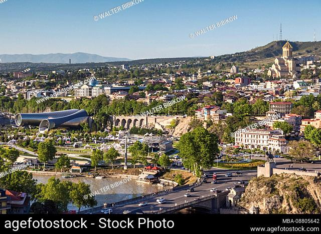 Georgia, Tbilisi, high angle view of city skyline from Narikala Fortress, late afternoon