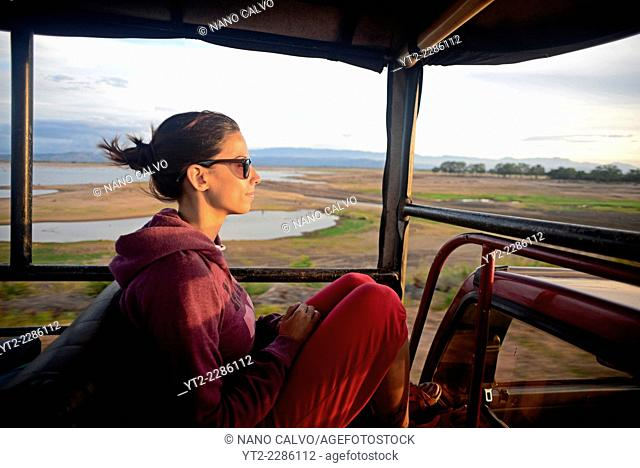 Young woman on safari jeep at Udawalawe National Park, Sri Lanka