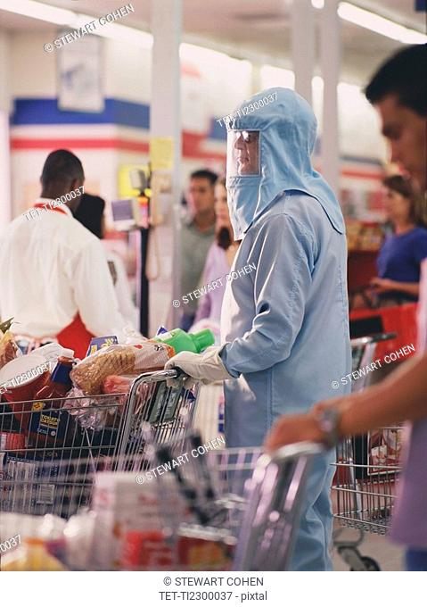 Woman in protective workwear in supermarket