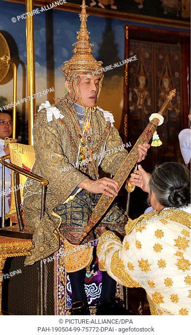 HANDOUT - 04 May 2019, Thailand, Bangkok: Maha Vajiralongkorn, King of Thailand, receives a sword sitting on the throne at his coronation