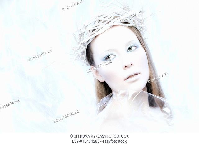 Fantasy ice queen theme, young beautiful woman, studio shot