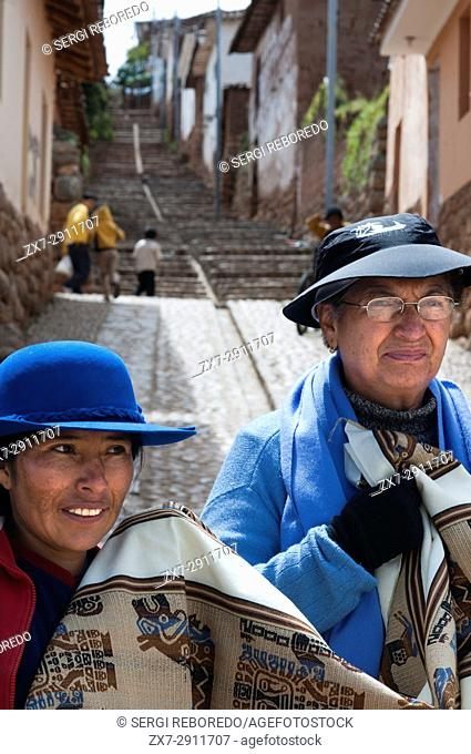 Local women with typical clothes in the small village of Chinchero in the Sacred Valley near Cuzco. Chinchero is a small Andean Indian village located high up...