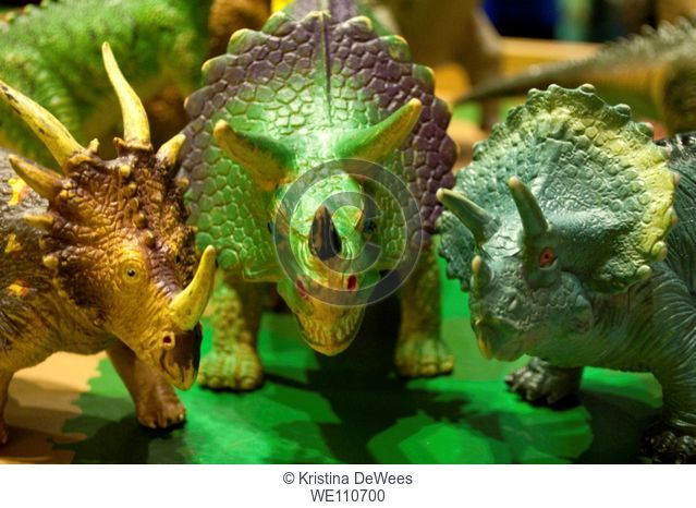 Three plastic dinosaurs