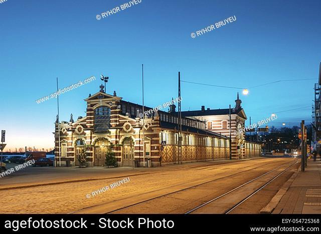 Helsinki, Finland. Old Market Hall Vanha Kauppahalli In Lighting In Evening Or Night Illumination. Famous Popular Place In Christmas Holiday Season