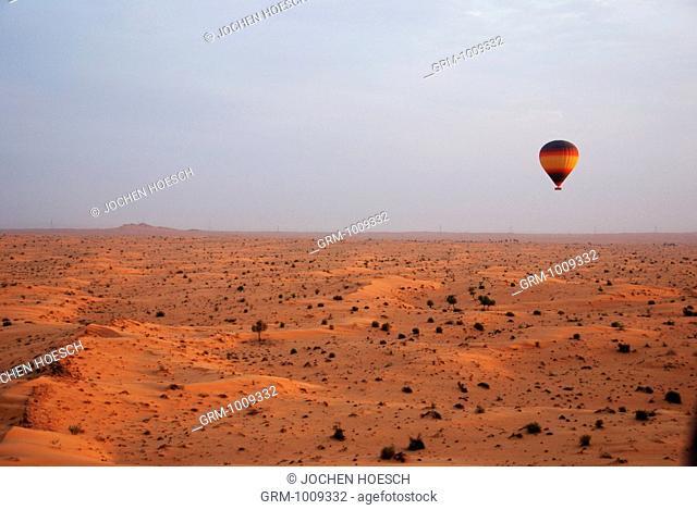Hot Air Balloon flying over the desert in Dubai, UAE